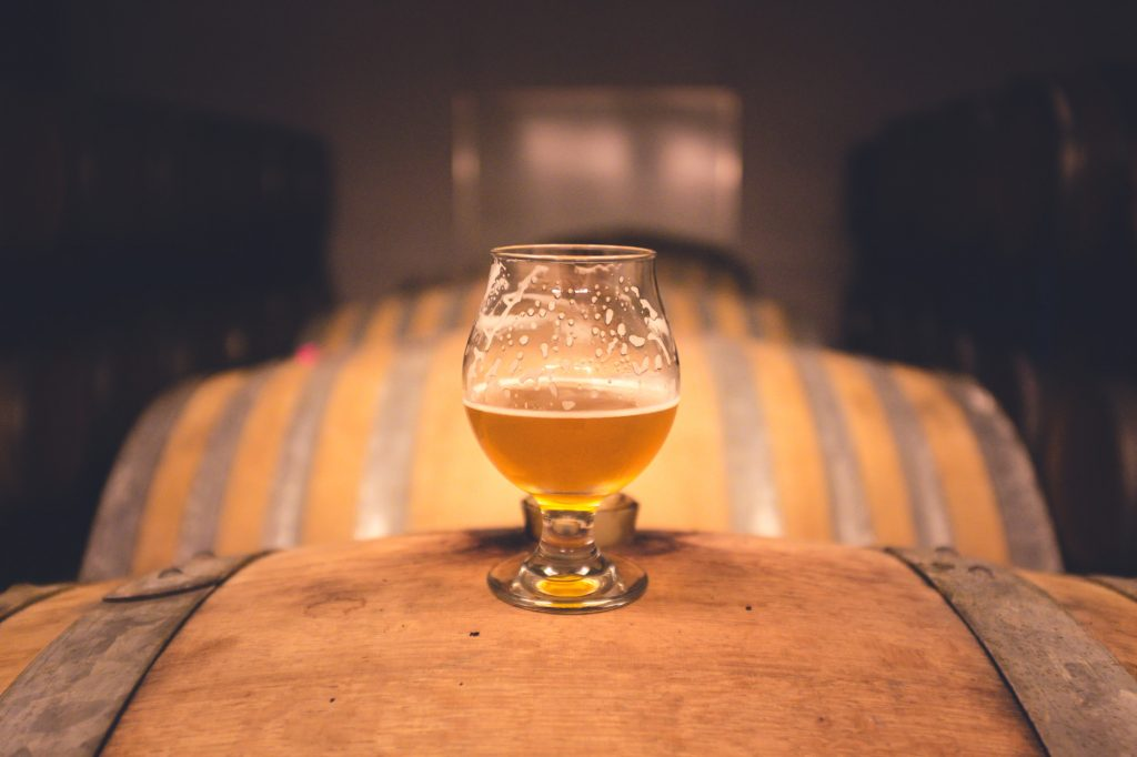 Craft brewers place beer on a Wooden Keg